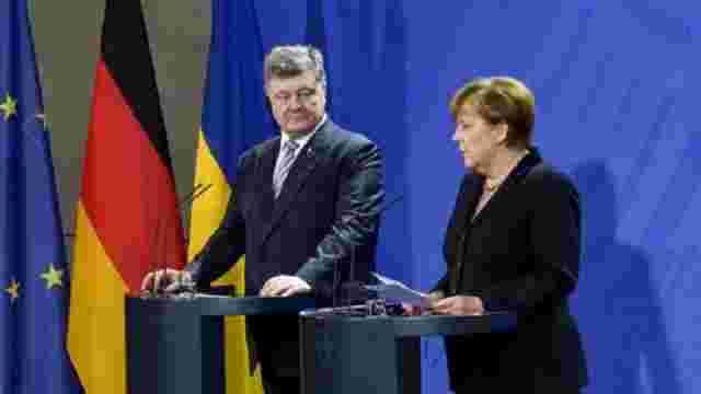 Меркель закликала Порошенка до виконання своєї частини Мінських угод