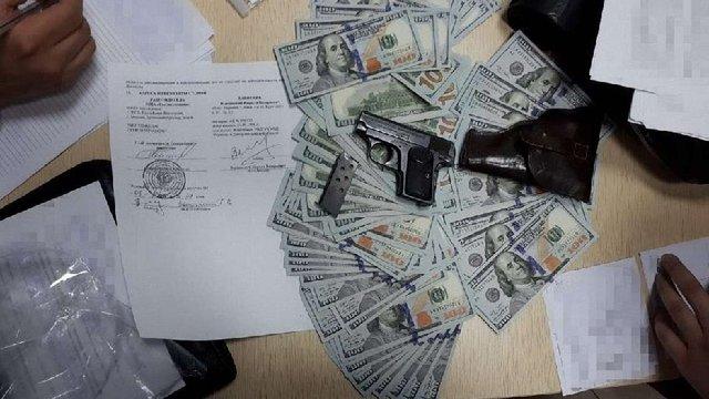 У банківській скриньці головреда «РИА Новости Украина» знайшли $200 тис. і пістолет