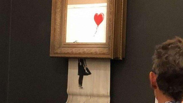 Картина художника Бенксі знищила себе одразу після продажу за мільйон фунтів