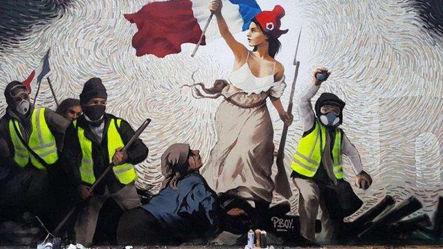 У Парижі вуличний художник заховав у муралі приз на тисячу доларів