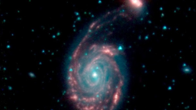 Телескоп Spitzer зафіксував згубне злиття галактик